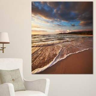 Designart 'Cloudy Sky over Wide Seashore' Large Seashore Canvas Print