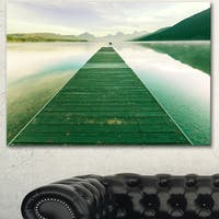 Designart 'Green Wood Pier At Glacier Park' Large Seashore Canvas Art