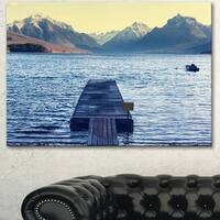 Designart 'Lake in Glacier National Park' Large Seashore Canvas Print - Blue