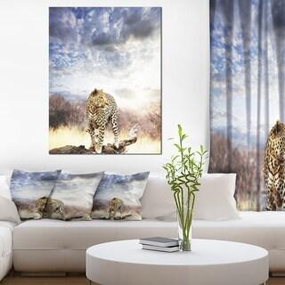 Designart 'Leopard Walking under Cloudy Sky' African Canvas Artwork