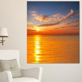 Designart 'Beautiful Sunset Reflecting in Sea ' Large Seashore Canvas Print