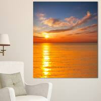 Designart 'Beautiful Sunset Reflecting in Sea ' Large Seashore Canvas Print