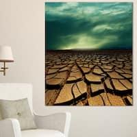 Designart 'Drought Land under Dramatic Blue Sky' African Landscape Print Wall Art