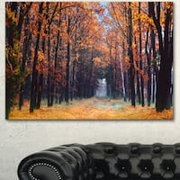 Designart 'Alley in the Dense Autumn Forest' Large Forest Canvas Art - Brown