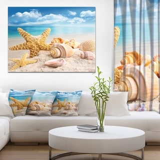 Designart 'Starfish and Seashells on Beach' Seashore Canvas Artwork Print