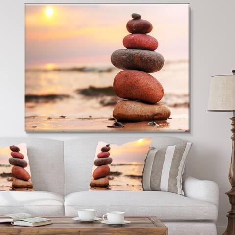 Designart 'Stones Pyramid on Sand Symbolizing Zen' Landscape Artwork Canvas Print - Pink