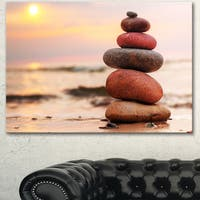 Designart 'Stones Pyramid on Sand Symbolizing Zen' Landscape Artwork Canvas Print - Pink