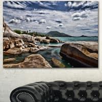 Designart 'Rocky Beach with Dramatic Sky' Large Seashore Canvas Artwork Print
