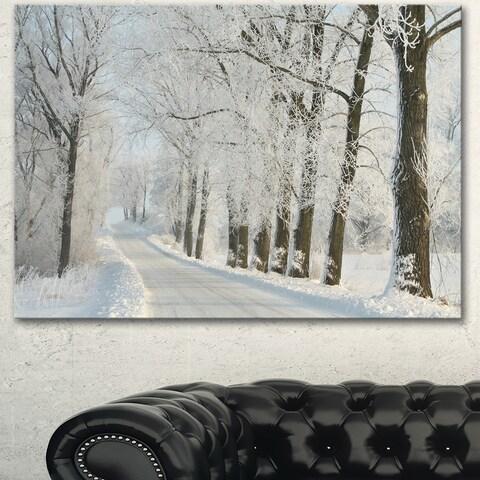Designart 'Winter Road in Dense Foggy Forest' Large Forest Artwork Canvas - White