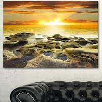 Designart 'Beautiful Orange Sundown Beach' Modern Seashore Canvas Wall Art Print