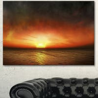 Designart 'Fiery Sunset Beach under Cloudy Sky' Modern Seashore Canvas Art