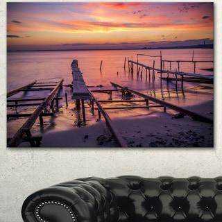 Designart 'Fishing Pier in Sea at Sunset' Modern Seashore Canvas Wall Art Print