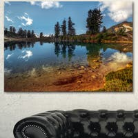 Designart 'Clear Lake with Row of Pine Trees' Extra Large Landscape Art Canvas