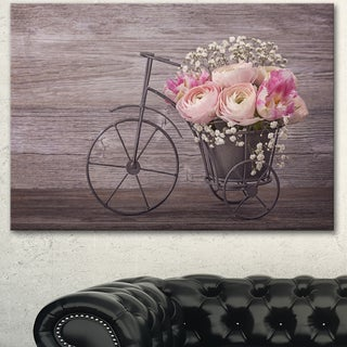 Designart 'Ranunculus Flowers on Bicycle' Floral Canvas Artwork Print - Brown