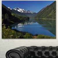 Designart 'Calm Clear Lake with Mountains' Extra Large Landscape Art Canvas - Green