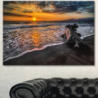 Designart 'Log on Beach During Sunset' Seashore Art Print on Canvas