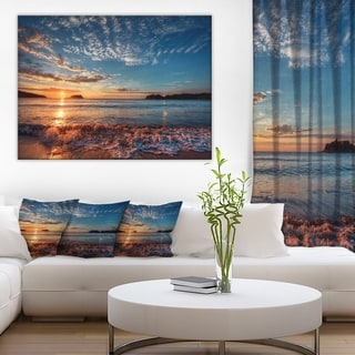 Tranquil Beach and Whimsical Clouds' Seashore Canvas Artwork Print