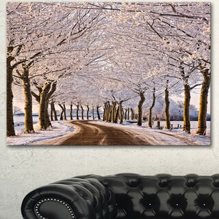 Designart 'Trees And Road in White Winter' Landscape Artwork Canvas Print