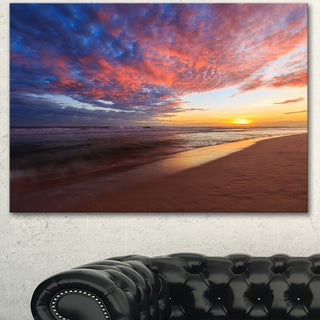 Designart 'Colored Clouds in Beach at Sunset' Large Seashore Canvas Artwork Print