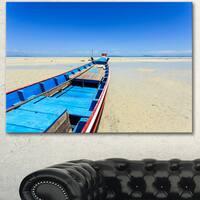 Designart 'Long Tail Boat Stand at the Beach' Modern Seashore Canvas Wall Art Print