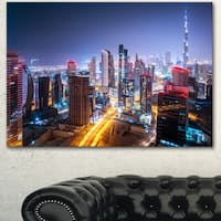 Designart 'Fantastic Night Cityscape' Extra Large Cityscape Wall Art on Canvas - Blue
