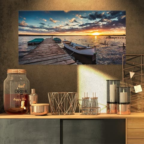 Designart 'Boats and Jetty under Dramatic Sky' Modern Bridge Canvas Wall Art