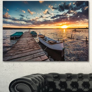 Designart 'Boats and Jetty under Dramatic Sky' Modern Bridge Canvas Wall Art (5 options available)