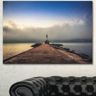 Designart 'Lighthouse on Coast and Cloudy Sky' Modern Bridge Canvas Wall Art