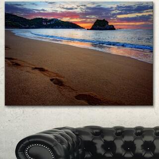 Designart 'Trodden Sand on Ocean Beach' Seashore Canvas Artwork Print