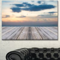Designart 'Wooden Board at Sunset Seashore' Modern Bridge Canvas Wall Art