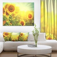 Sunflowers blooming on the field' Large Animal Canvas Wall Art Print - Yellow
