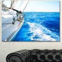 Designart 'White Sailing Yacht in Blue Sea' Large Seashore Canvas Wall Art