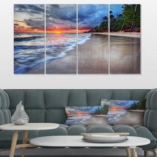 Designart 'Fluffy Dark Clouds over Ocean' Seashore Art Print on Canvas