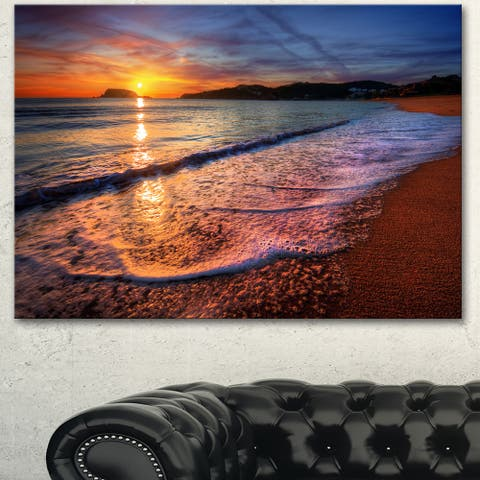 Designart 'Foaming Waves at Beautiful Sunset' Seashore Art Print on Canvas