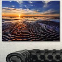 Designart 'Waves On the Sand During Sunset' Seashore Art Print on Canvas