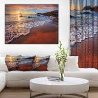 Designart 'Stunning Ocean Beach at Sunset' Seashore Art Print on Canvas - Red