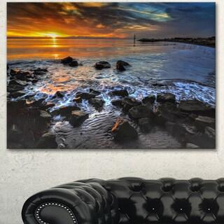 Designart 'Sunset over Rocky Ocean Shore' Large Landscape Art Canvas Print - Grey
