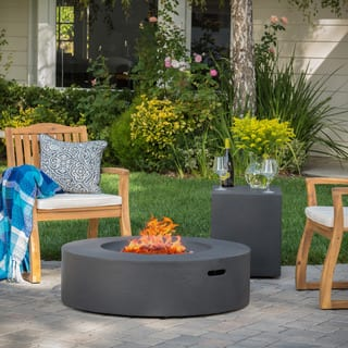 Santos Outdoor Circular Propane Fire Pit Table with Tank Holder by Christopher Knight Home https://ak1.ostkcdn.com/images/products/13181165/P19903762.jpg?impolicy=medium