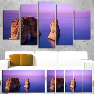 Designart 'Rawsha Rock on Sunset' Seashore Canvas Wall Artwork