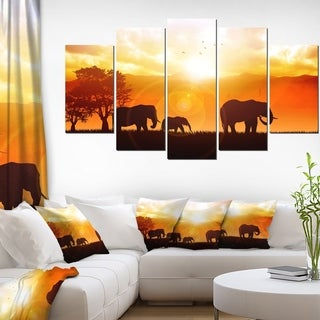 Designart 'Elephants Walking At Sunset' African Canvas Artwork