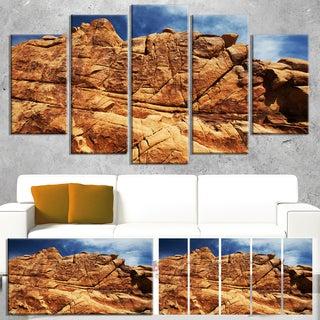 Designart 'Rocky Terrain under Blue Sky' African Landscape Art Print Canvas