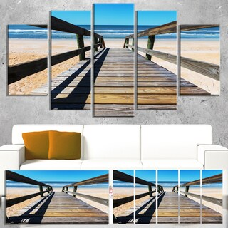 Designart 'Long Boardwalk into Blue Seashore' Large Seashore Canvas Art