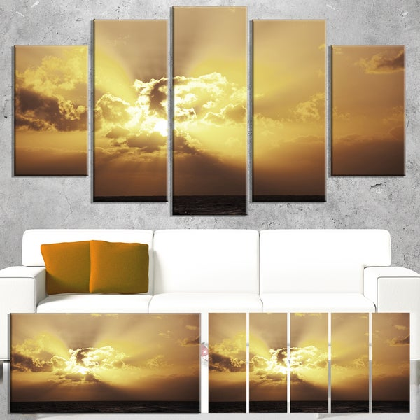 Designart 'Majestic Sea Sunset Through Clouds' Landscape Print Wall Art
