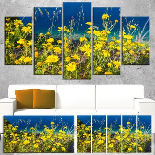Designart 'Wild Yellow Flowers over Sea Coast' Large Flower Wall Artwork