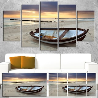 Designart 'Boat on Beautiful Sunrise Seashore' Large Beach Canvas Wall Art - Multi