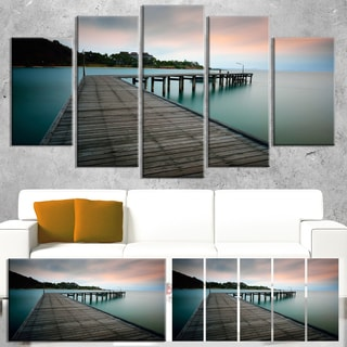 Designart 'Wooden Bridge into Blue Sea' Modern Bridge Canvas Wall Art