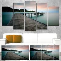 Designart 'Wooden Bridge into Blue Sea' Modern Bridge Canvas Wall Art