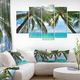 Designart 'Palm Hanging over Sandy White Beach' Seashore Canvas Artwork Print