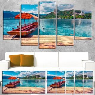Designart 'Boat in Lake Bled In Julian Alps' Large Landscape Art Canvas Print - Blue