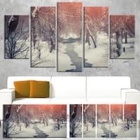 Designart 'Beautiful Snowfall in City Park' Landscape Artwork Canvas Print - White